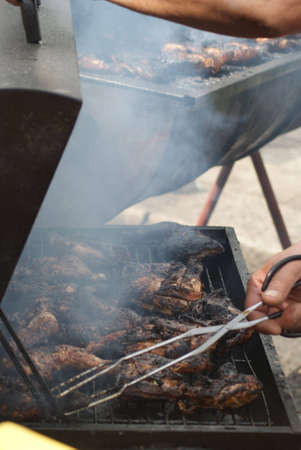 London, England - 30 August 2010 - Man cooking jerk chicken at the Notting Hill Carnival Stock Photo - 7798509