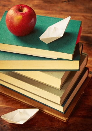 Vintage old books on wooden tabletop photo
