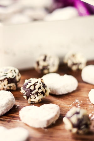 Chocolate almond candies and vanilla cookies Stock Photo