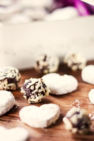 Chocolate almond candies and vanilla cookies Standard-Bild