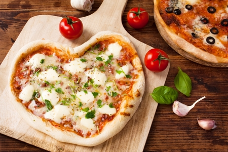 Romantic Heart Shaped Italian Pizza Margherita  Stock Photo