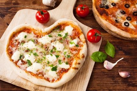 favourites: Romantic Heart Shaped Italian Pizza Margherita  Stock Photo