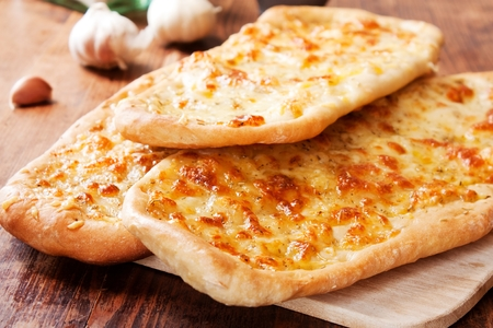 Italian Focaccia bread with garlic, rosemary and mozzarella Stock Photo