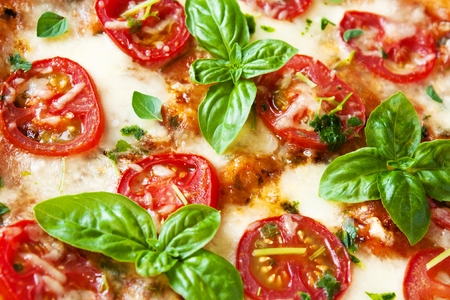 Italian Pizza Margherita with basil and fresh tomatoes