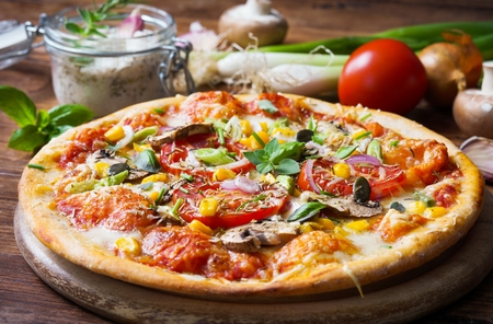 Homemade pizza with vegetables and fresh herbs Stock Photo