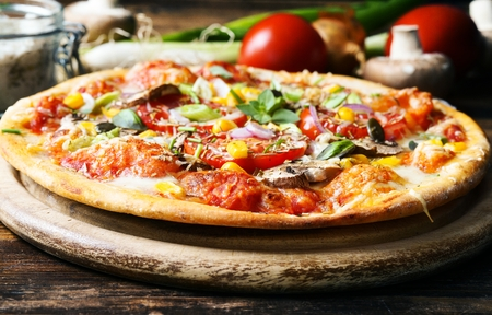 Homemade pizza with vegetables and fresh herbs Stock Photo - 81653543