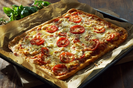 Homemade Italian Pizza on baking sheet Stock Photo