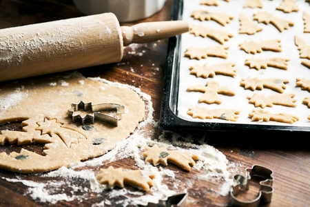 Baking Christmas Cookies / cookie dough, rolling pin, cookie cutter and baking sheet Stock Photo - 90001733