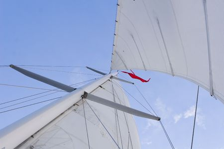 A set of full sails on a sailboat looking up Stok Fotoğraf