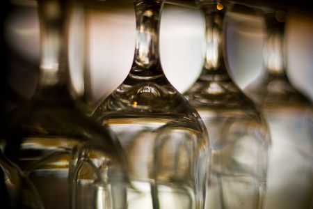 Empty wine glasses hanging upside down