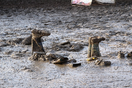 wellies: Wellies and mud at Glastonbury festival