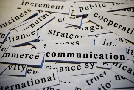 Communication, cut-out of words related with business photo
