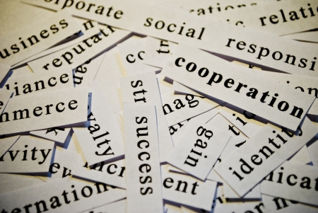 Cooperation, cut-out of words related with business photo