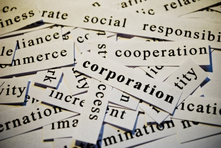Corporation, cut-out of words related with business photo