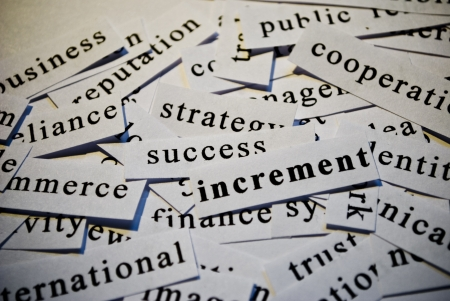 Increment, cut-out of words related with business  photo