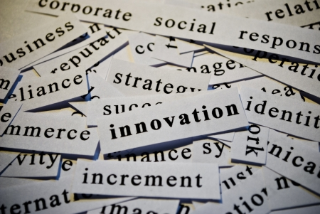 Innovation, cut-out of words related with business  photo