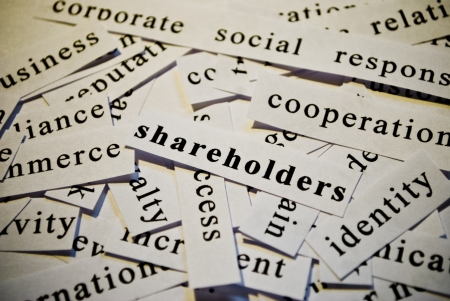 Shareholders, cut-out of words related with business  photo