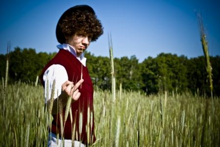 vulgar: Young fashionable man showing vulgar gesture