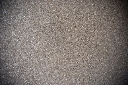 Natural brown wooden grained cork board background or texture photo