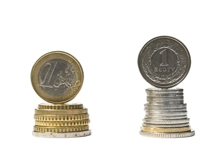 Stack of money euro and zloty coins  Currency rate comparison concept Stock Photo