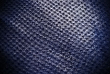 holed: Holed and creased navy blue canvas background or texture