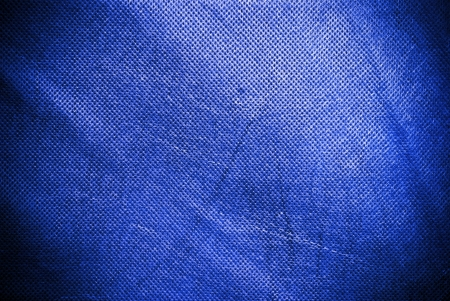 holed: Holed and creased blue canvas background or texture