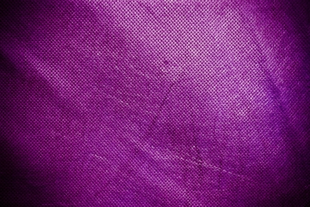 holed: Holed and creased pink canvas background or texture Stock Photo