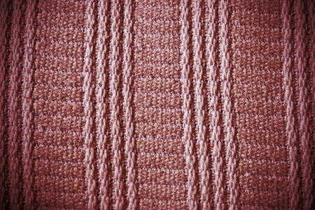 Red woven striped material background or texture photo