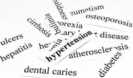 Hypertension  Health care concept of diseases caused by unhealthy nutrition Stock Photo