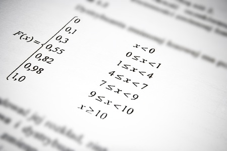 Mathematical formulas and calculations in university textbook  Math education concept  photo