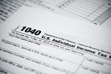 Blank income tax forms  American 1040 Individual Income Tax return form  Stock Photo