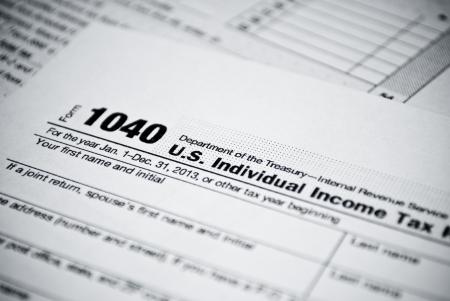 taxes: Formularios de impuestos en blanco americano 1040 Formulario de declaraci�n de Impuesto sobre el Ingreso Personal Foto de archivo