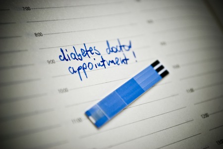 reminding: Health care concept  Stripes for glucose test and reminding note in personal organiser  Concept concerning diabetes