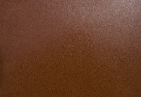 Brown leather background or texture photo