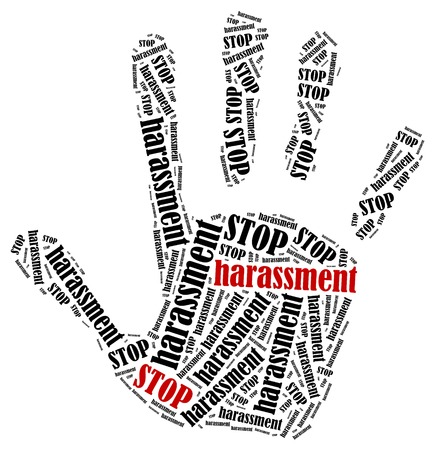 stop hand silhouette: Stop harassment. Word cloud illustration in shape of hand print showing protest. Stock Photo