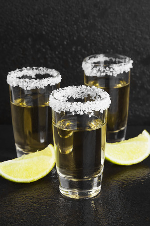 fruit of the spirit: Tequila with salt and lime on a dark background Stock Photo