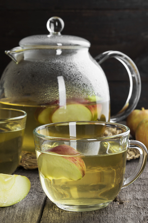 punch spice: Apple tea on a dark wooden background Stock Photo
