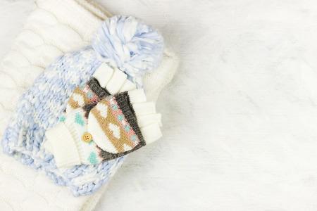Warm woolen clothes on a white background