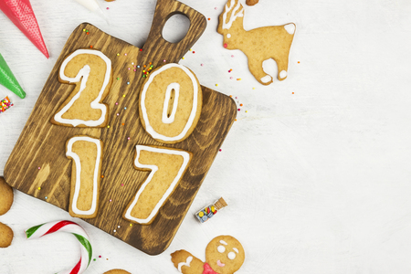 Ingredients for ginger cookies in the form of new 2017 year on a white background Stock Photo