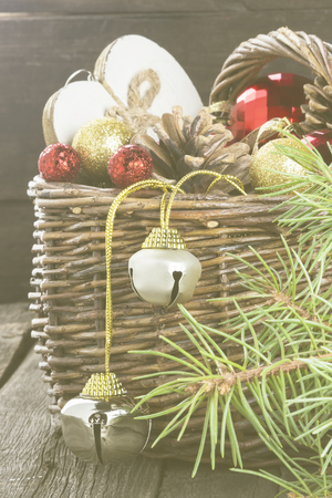 toning: Christmas jewelry in a basket on a wooden background. Toning