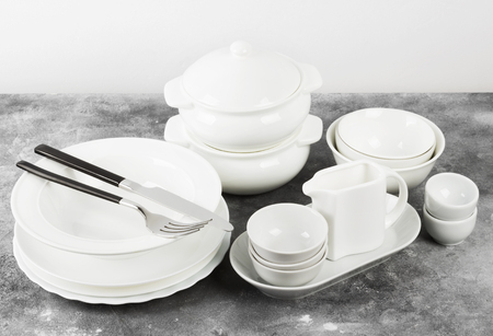 Clean white tableware on a gray background Reklamní fotografie