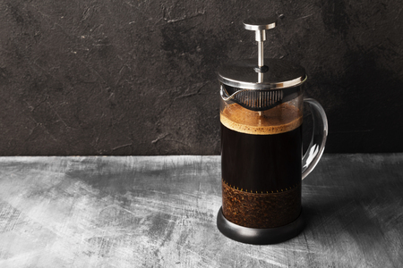 Coffee in french press on dark background. Copy space. Food background Stockfoto