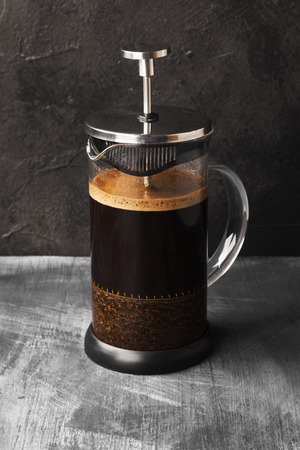 Coffee in french press on dark background 写真素材