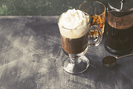 Irish coffee with whisky on dark background. Copy space. Food background. Toned