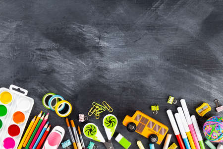 Various school office and painting supplies on black background. Back to school concept. Top view. Copy space Zdjęcie Seryjne