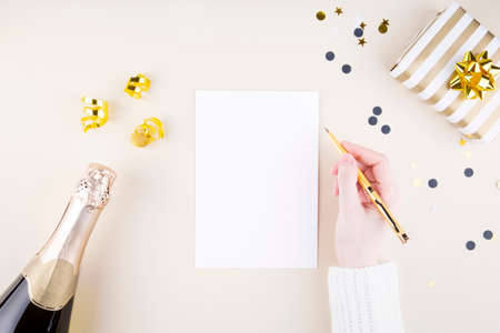 Holiday attributes. Girl writes plans for new year. Top view. Copy space Stock fotó