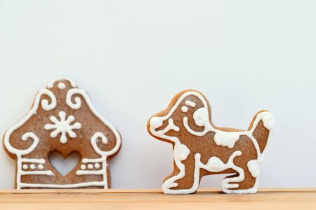 Gingerbread dog and house - living in a village Фото со стока