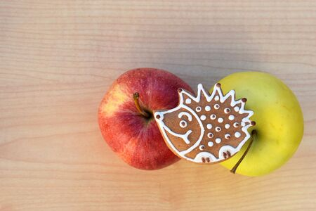 Gingerbread hedgehog with colorful apples