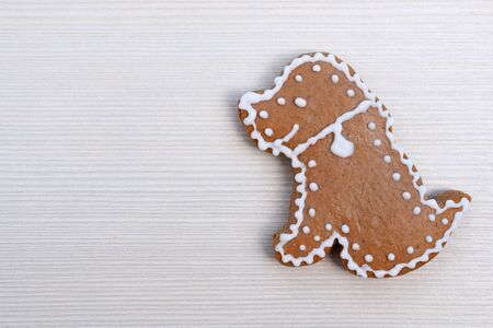 Cute gingerbread dog on wooden