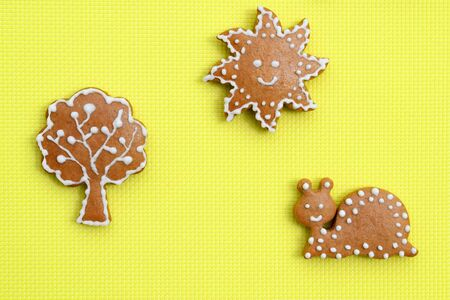 Creative composition with ginger breads on bright yellow
